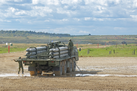 weaponry: MILITARY GROUND ALABINO, MOSCOW OBLAST, RUSSIA - SEP 10, 2016: Transport-loading vehicle BM-30 Smerch is a Russian heavy multiple rocket launcher at the International military-technical forum ARMY-2016 Editorial