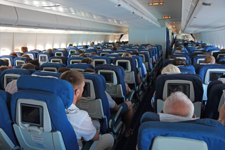 long haul journey: MOSCOW, RUSSIA - AUG 09, 2015: Passengers on board the aircraft Boeing-747, Russian airlines Transaero