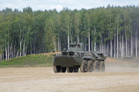 armoured: MILITARY GROUND ALABINO, MOSCOW OBLAST, RUSSIA - SEP 10, 2016: The BTR-82a is a Russian 8x8 wheeled amphibious armoured personnel carrier (APC) at the International military-technical forum ARMY-2016 Editorial