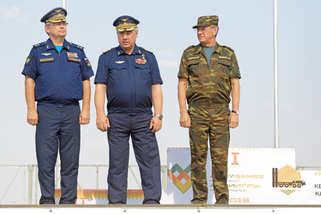 ASHULUK TRAINING AREA, ASTRAKHAN REGION, RUSSIA - AUG 07, 2016: Commander of air and missile defense of Russia Viktor Gumenny, Commander-in-Chief of the Russian Air Force Viktor Bondarev and Governor of Astrakhan region Alexander Zhilkin in the contest K