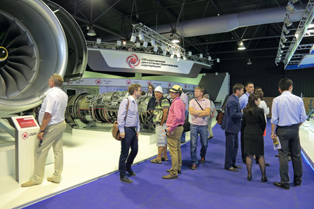 aeroengine: ZHUKOVSKY, MOSCOW REGION, RUSSIA - AUG 26, 2015: The stand of the United engine Corporation. Visitors view the aircraft turbojet engines at the International Aviation and Space salon MAKS-2015 Editorial