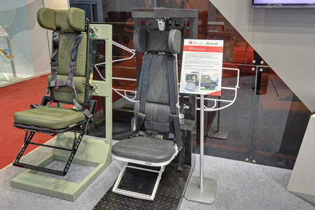 compensate: KUBINKA, MOSCOW OBLAST, RUSSIA - SEP 06, 2016: Energy-absorbing seats to compensate for shock loads in the fall or explosion at the International military-technical forum ARMY-2016 Editorial