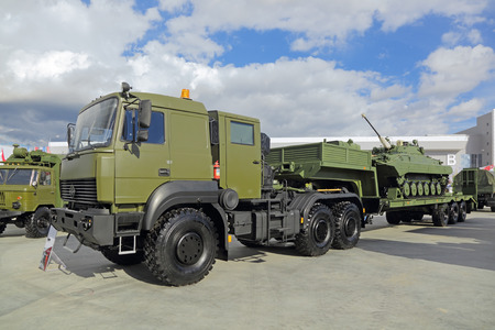 flatcar: KUBINKA, MOSCOW OBLAST, RUSSIA - SEP 06, 2016: International military-technical forum ARMY-2016. Ural-63704 with semitrailer for transportation of heavy military equipment