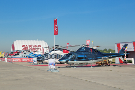 principally: ZHUKOVSKY, MOSCOW REGION, RUSSIA - AUG 25, 2015: AW119 Ke Koala medium sized single-engined helicopter developed and produced principally by AgustaWestland at the International Aviation and Space salon MAKS-2015 Editorial