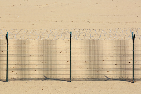 wire fence: Metal fence with barbed wire Stock Photo