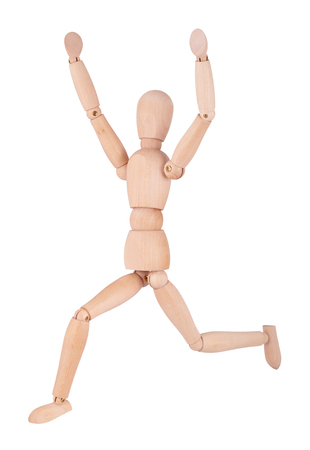 Wooden ball-jointed doll isolated on white background shows a man running with their hands up