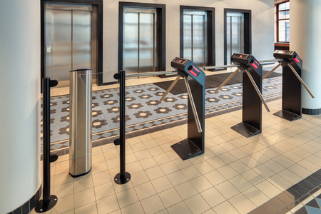 cardkey: The turnstile in a modern office building