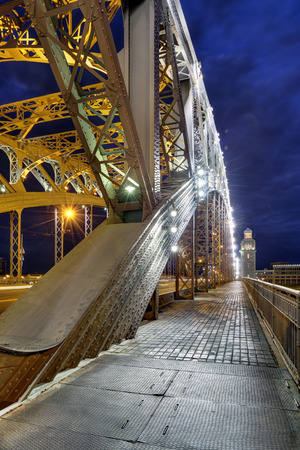 Bolsheokhtinsky Bridge (before 1917 - Peter the Great Bridge) also known as Okhtinsky Bridge is a bridge across the Neva River in Saint Petersburg, Russia