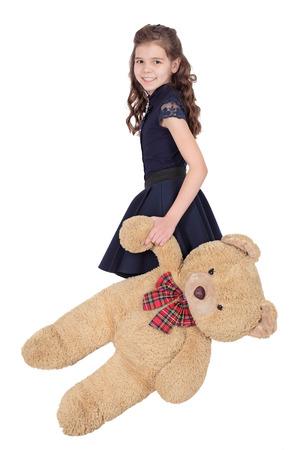 Girl with plush bear, isolated on white background