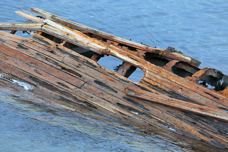 sunken: The wreckage of an old sunken ship in the water Stock Photo