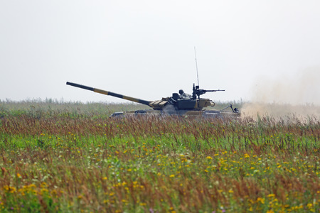 Tank rides on the field Stock Photo