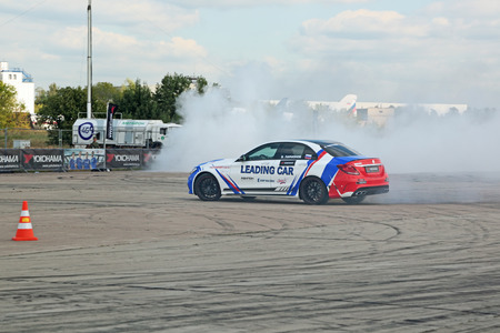 traction: ZHUKOVSKY, MOSCOW REGION, RUSSIA - AUG 28, 2015: Drift show in the advertising of the manufacturer of tires Yokohama at the International Aviation and Space salon MAKS-2015