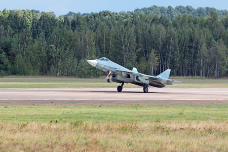 frontline: ZHUKOVSKY, MOSCOW REGION, RUSSIA - AUG 30, 2015: Landing Sukhoi PAK FA T-50 (Prospective Airborne Complex of Frontline Aviation) fifth-generation jet fighter at the International Aviation and Space salon MAKS-2015