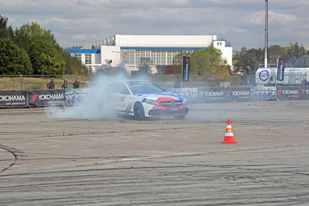 slew: ZHUKOVSKY, MOSCOW REGION, RUSSIA - AUG 28, 2015: Drift show in the advertising of the manufacturer of tires Yokohama at the International Aviation and Space salon MAKS-2015