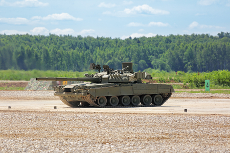 weaponry: MILITARY GROUND ALABINO, MOSCOW OBLAST, RUSSIA - JUN 18, 2015: Russian tanks in show of military equipment on military ground at the International military-technical forum ARMY-2015