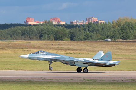 ZHUKOVSKY, MOSCOW REGION, RUSSIA - AUG 30, 2015: Landing Sukhoi PAK FA T-50 (Prospective Airborne Complex of Frontline Aviation) fifth-generation jet fighter at the International Aviation and Space salon MAKS-2015