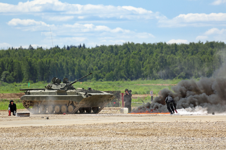 weaponry: MILITARY GROUND ALABINO, MOSCOW REGION, RUSSIA - JUN 18, 2015: The fighting fire at the International military-technical forum ARMY-2015