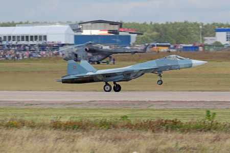 frontline: ZHUKOVSKY, MOSCOW REGION, RUSSIA - AUG 28, 2015: Takeoff Sukhoi PAK FA T-50 (Prospective Airborne Complex of Frontline Aviation) fifth-generation jet fighter at the International Aviation and Space salon MAKS-2015