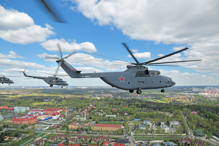 may fly: MOSCOW, RUSSIA - MAY 05, 2015: Rehearsal of parade of the 70th anniversary of the Victory Day (WWII). A group of military helicopters the participants of the Airshow fly to Moscow from the Kubinka airfield Editorial