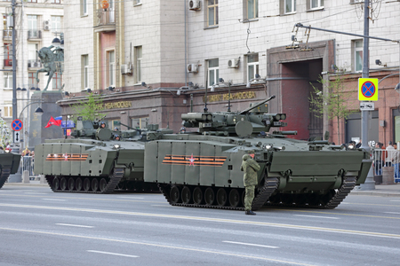 tr: MOSCOW, RUSSIA - MAY 05, 2016: Rehearsal celebration of the 71th anniversary of the Victory Day (WWII). Military equipment on Tverskaya street prepares to travel to the Red Square. The infantry combat vehicle on the basis of a promising platform medium tr