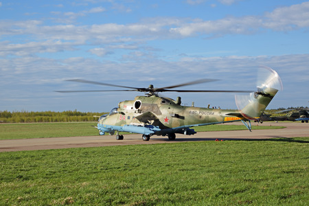 KUBINKA, MOSCOW REGION, RUSSIA - MAY 07, 2017: The Mil Mi-24 also known as Mi-35 (NATO reporting name: Hind) is a attack helicopter and low-capacity troop transport preparing to fly over Moscow in rehearsal 72 anniversary of the Victory Parade in WWII Editorial