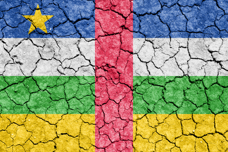 The image of the flag of Central African Republic on the cracked dry ground Stock Photo
