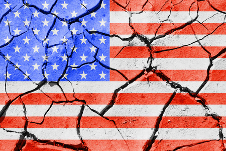 The image of the flag of United States of America on the cracked dry ground Stock Photo