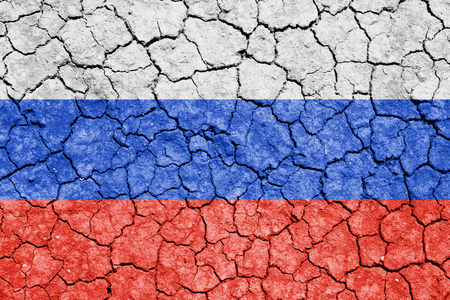 The image of the flag of Russian Federation on the cracked dry ground Stock Photo