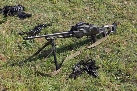 The machine gun and machine gun tape on green grass, nobody Stok Fotoğraf