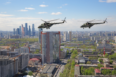 MOSCOW, RUSSIA - MAY 07, 2017: A group of Mil Mi-8 helicopters fly over the Moscow to participate in the rehearsal of the passage of aircraft in the parade of Victory Day in WWII Editorial