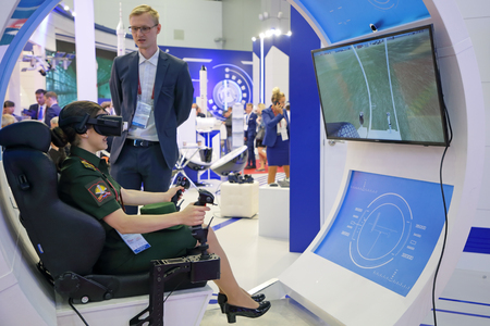 KUBINKA, MOSCOW OBLAST, RUSSIA - AUG 22, 2018: International military-technical forum ARMY-2018. Visitors learn aviation simulator
