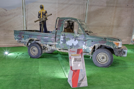 KUBINKA, MOSCOW OBLAST, RUSSIA - AUG 22, 2018: International military-technical forum ARMY-2018. Syrian exhibition. Off-road vehicle with artisanal-mounted guide NURS captured from terrorists in Syria