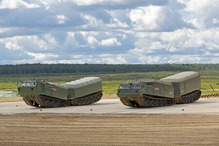 MILITARY GROUND ALABINO, MOSCOW OBLAST, RUSSIA - AUG 22, 2018: The two-tier tracked all-terrain amphibian vehicles DT-10P and DT-30P at the International military-technical forum ARMY-2018 Sajtókép
