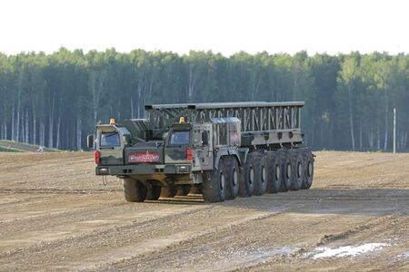 MILITARY GROUND ALABINO, MOSCOW OBLAST, RUSSIA - AUG 21, 2018: The multi-axle wheeled chassis KAMAZ-7850 from the family