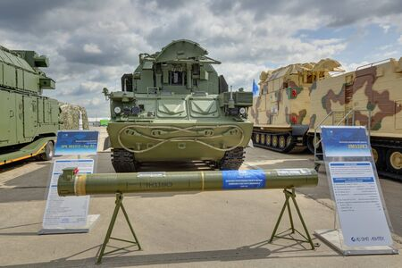 ZHUKOVSKY, MOSCOW REGION, RUSSIA - AUG 26, 2019: Combat vehicle and anti-aircraft guided missile from the Tor-E2 air defense system (SA-15 Gauntlet) at the International Aviation and Space salon MAKS-2019