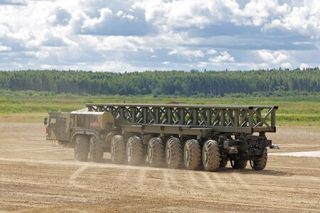 MILITARY GROUND ALABINO, MOSCOW OBLAST, RUSSIA - AUG 22, 2018: The multi-axle wheeled chassis KAMAZ-7850 from the family