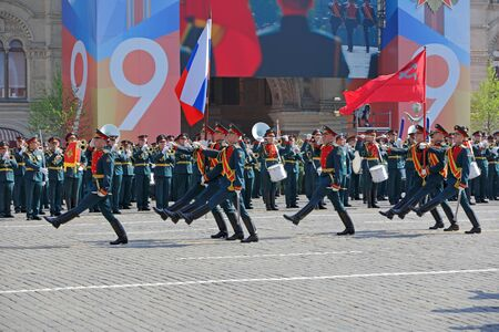 MOSCOW, RUSSIA - MAY 07, 2019: Rehearsal of the Victory Day celebration (WWII). Solemn passage of military hardware on Red Square. Standard-bearers carry the banner of victory
