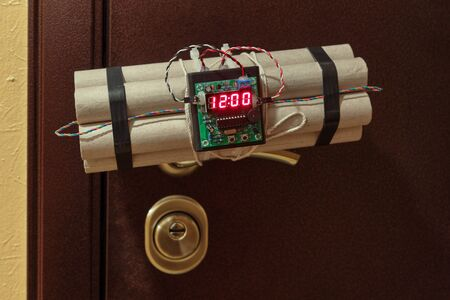 An explosive device with a clockwork mechanism, attached to the door handle