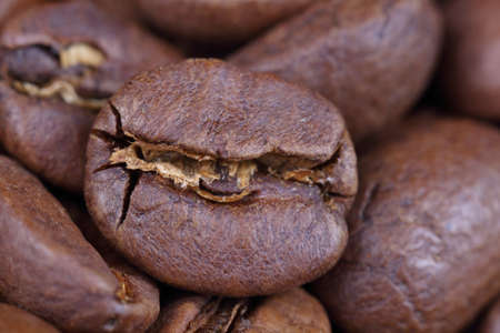Coffee roasted beans, close-up, macro