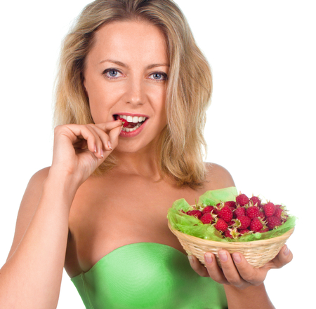 Close up of smiling woman holding raspberries isolated on white photo