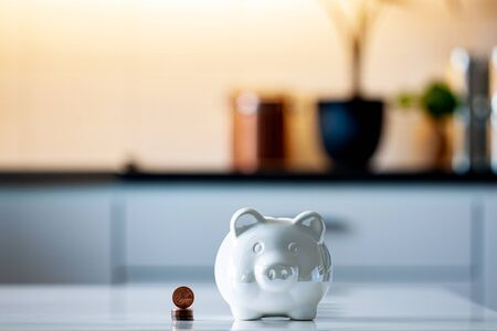 Personal finances, close-up of a piggy bank with american dollars - wealth and financial concept. White piggy bank in the foreground. Фото со стока