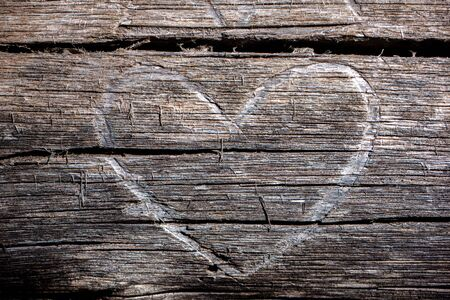 Heart carved into surface of an old tree trunk