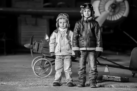 aviators: Young aviators in homemade aircraft in a large hangar Stock Photo