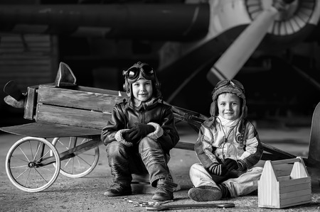 aviators: Young Aviators in a homemade aircraft in a hangar with these planes