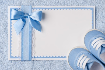 new born: Blank cards with boots in blue birthday Stock Photo