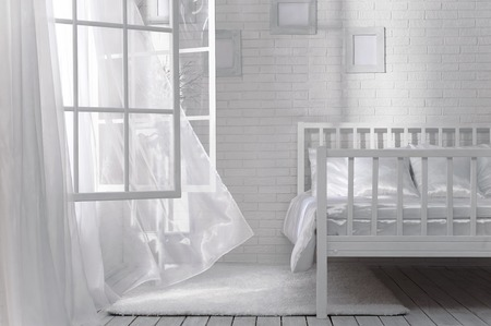 open windows: Bedroom with an open window and a light breeze on a sunny day Stock Photo