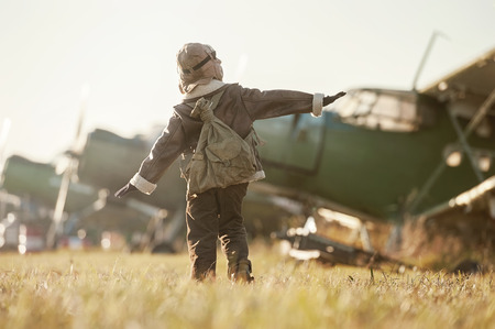 Young Aviator parked aircraft at the airport autumn day Stock Photo
