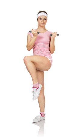 exercitation: Young woman is engaged fitness in studio on white