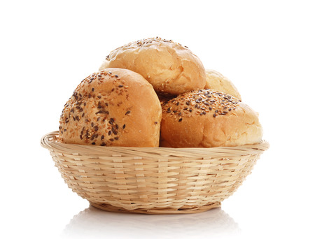 bread basket: Buns with sesame in a woven basket on a white background