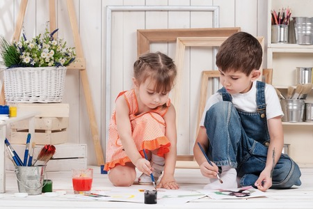 Little boy and girl painted in studio photo